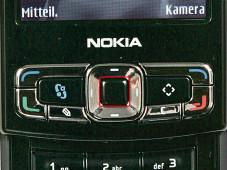 WLAN per Nokia-Handy Über das Handy Menü steuern Sie die Eingabe, bei der rot markierten Taste handelt es sich um die Bestätigungstaste.