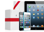 iPhone und iPad mit Geschenkkarton���Apple