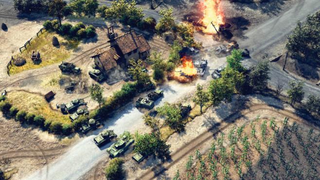 """Sudden Strike 4: Panzer im Anmarsch! Kaputte Panzer verschwinden in """"Sudden Strike 4"""" nicht einfach, sondern dienen als Straßensperre. ©Kalypso"""