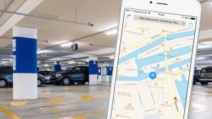 Parkhaus und Smartphone ©Copyrights: Apple, Studio Gi � Fotolia.com