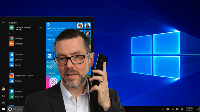 Windows 10 S: COMPUTER BILD-Ressortleiter Christian Just vor dem Homescreen ©Montage: COMPUTER BILD/Screenshot: Microsoft