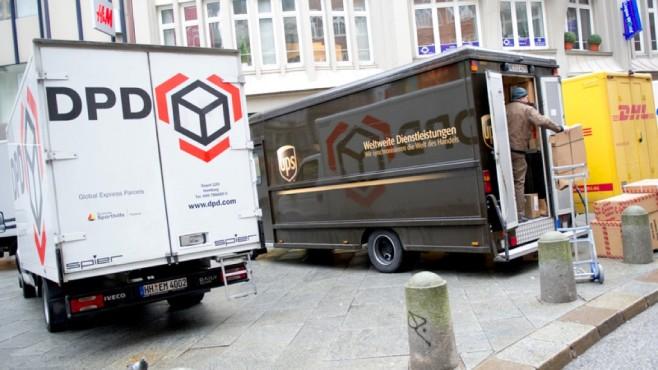 Lieferwagen von DPD, UPS und DHL©dpa Bildfunk