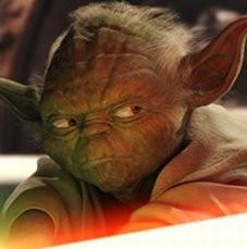 Noch mehr Ostereier suchen auf Film-DVDs Der gebrechliche Jedi-Meister Yoda ist beim Kämpfen mit dem Laserschwert©George Lucas Films