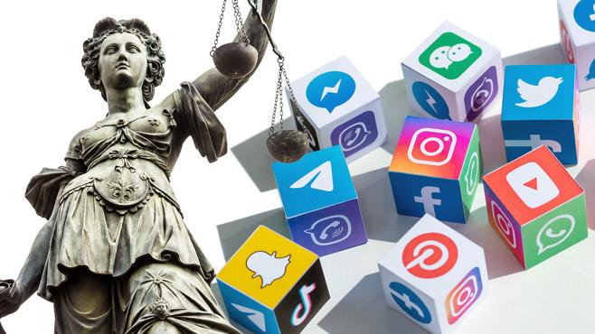 Justitia-Statue neben Social-Media-Logos©iStock.com/querbeet, iStock.com/pressureUA