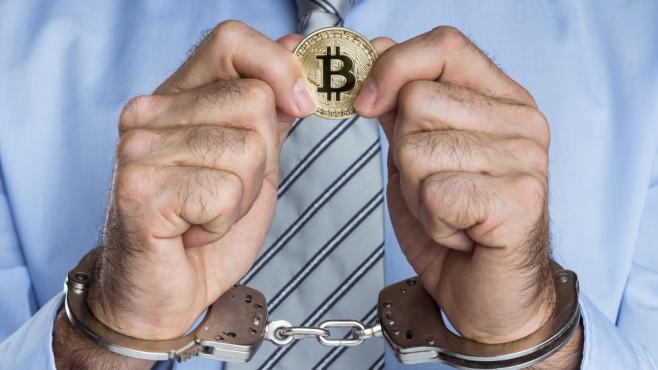 Bitcoin und gefesselte Hände©iStock.com/D-Keine