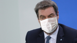Markus Söder mit Maske © Pool / Getty Images
