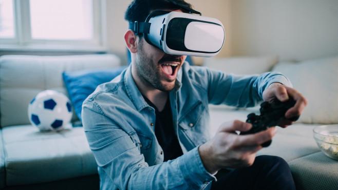 Gaming-Aktien: Mit diesen Papieren kann man spielend Geld verdienen Verrückt nach Action: In der Pandemie ist die Nachfrage nach Videospielen besonders hoch. Doch auch ohne Corona wächst der Markt und macht Gaming-Aktien für Anleger interessant.©iStock.com/RgStudio