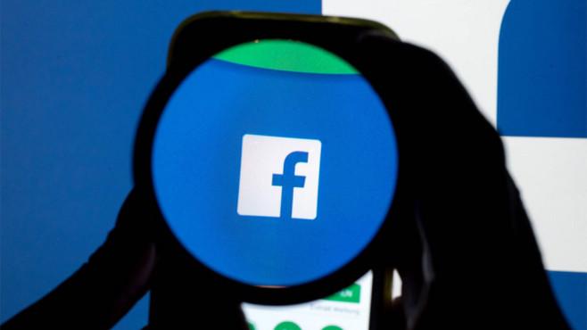 Facebook-Logo unter der Lupe©dpa-Bildfunk