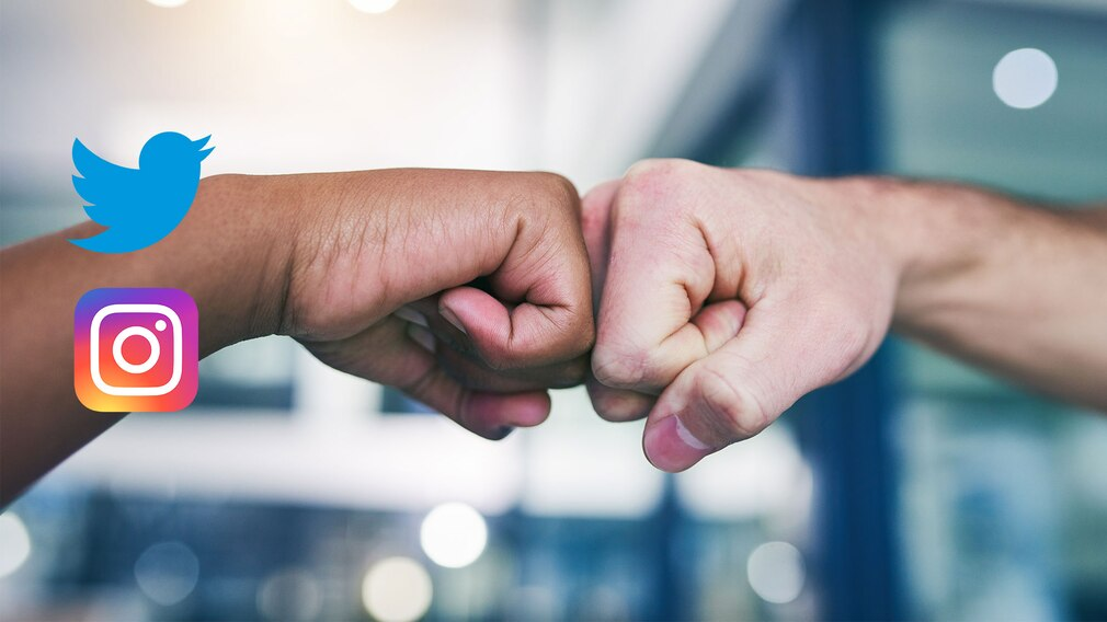 Fist Bump von zwei Fäusten, Instagram- und Twitter-Logo