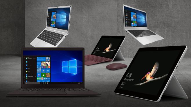 Notebooks und Tablets vor grauem Hintergrund©iStock.com/jm1366, Peaq, Microsoft, Trekstor