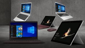 Diverse Notebooks und Tablets vor grauem Hintergrund©iStock.com/jm1366, Peaq, Microsoft, Trekstor