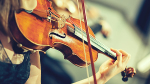 © Fotolia--DeshaCAM-Symphony orchestra on stage, hands playing violin